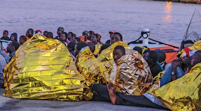 Refugiados recién llegados a Lampedusa